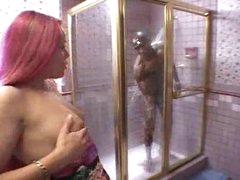 Darksome beauty sucks monster black cock in shower