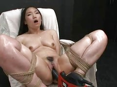 Hot Oriental beauty bound and drilled with fucking machine