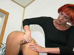 Redhead lesbian honey fingering constricted wazoo previous to strap-on screwing on floor