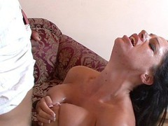 Angela Aspen uses her enormous love bubbles to titty fuck her stud partner here, getting on her knees and blowing his jock until the load is popping right onto her tongue.  This Babe desperately wants to taste that sweet cock juice and works it to the finish.