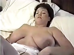 This homemade episode is a mix of sexy episode scenes I have taken of my huge-titted wife. You can watch her strip, give me blowjob, shave her cunt, masturbate during the time that I fuck her, play with sex toys and take a bath.