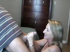 This lady loves to handle and suck her husband's cock.  This sweetheart sucks it, puts on some flavored lube, and the strokes the shaft during the time that this sweetheart tonguing the tip in her mouth.  That fellow lastly cums in her mouth, moaning, and this sweetheart swallows, with just a little bit of the cum dribbling out.