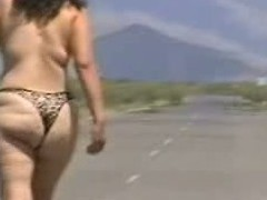 Out in the open desert walking in the middle of a highway with only a g-string covering her large booty body. In this public sex video u can see this older doxy walk undressed out in the open and flaunt her large fucking ass.
