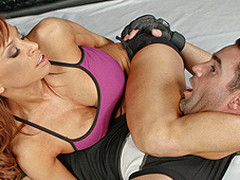 Devon, a MMA fighter with a background in stand-up fighting, enlists the assist of Charles, who teaches her the finer points of wrestling on her back.