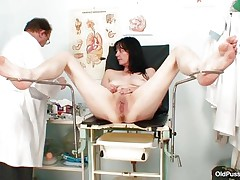 Older dark brown hair women with priceless body and wicked love melons is sitting the gynecologist table absolutely undressed with her legs spread so that her doctor can exam the wet crack between them. He recommends her a dildo therapy so the treatment begins as he introduces that sex toy unfathomable in her shaved vagina. This playgirl becomes excited and does treats her slit with her own hands.