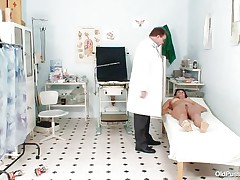 Naked Mature lady with large tits visits the doctor for her twat examination. That sweetheart is ordered to lay on the patient's daybed doctor examines her belly and then wears his gloves and tells her to widen her legs so that her cunt can be tested. Doctor examines it and then checks her a-hole and ask her if that sweetheart had anal sex ever that sweetheart replied with no.