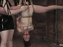 Claire Adams has Trinity Post's slit wired. She's not merely bound up but upside down, and gagged to boot. She's got a metal plug in her cunt and Claire's using a sextoy on her clit, making her crave to cum. That babe acquires permission to cum and that babe does several times, moaning loudly throughout her ball gag.