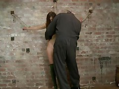 Our cute wench Casey wears a couple of high heels boots and no thing more. This babe looks precious like that and the executor is glad to castigate her hot body. This guy bound her on the wall, ball gagged her and used a rope to pull her body up while that babe was still bound on that wall. Look how much that babe suffers and endures for our pleasure