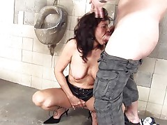 She's a filthy slut and does anything a man asks her. Here that babe is, in an abandoned public toilet sucking this stud and then licking his dark hole before that guy fucks her from behind. She's a cougar that enjoys a worthy filthy fuck and probably will have a fun his semen too so stick with us and watch this doxy in full action