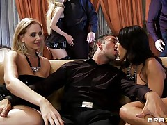 A golden-haired and a darksome brown are rubbing a guy's crotch whilst sitting on a couch. They pull out his cock and begin to engulf it, every awaiting her turn. Another dick enters the scene and the darksome brown goes to blow it.
