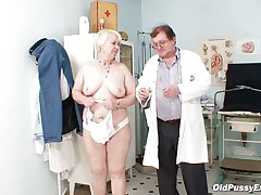 Bozena is a older lady with big boobs, lascivious face and big ass. After doctor asks her to disrobe this man is using a engulfing machine to make her nipples harder. This doc has a messy mind and surely this man is making her horny, who knows what tricks this man has to make this old bitch ready to fuck.