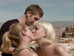 They are in the desert, the burning sun is upon 'em and made 'em insanely hawt so they fuck like crazy, one hottie licks the other ones fur pie and gets fucked in the rectal hole with a dildo. The blond that is receiving a tongue in her fur pie is fastened and lays on the sand, will the guy cool her with some sperm?