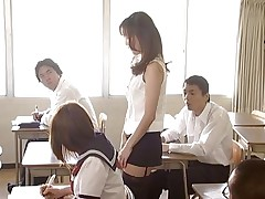 Manami Suzuki can't live out of teaching. Someone's out to expose her for the bitch that chick indeed is, hitting the remote control of her vibrator, causing her to groan as that chick walks through the class. A student's father comes in, his son saying the teacher's a porn star. Charming pretty soon she's nude in front of the class.