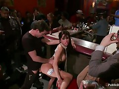 Gia DiMarco is on a rope leash, getting screwed in the ass right in the centre of the bar while the patrons watch. This playgirl continuously thanks James Deen for fucking her ass. Then she's on the floor, getting fingered by a woman, squirting all over. This playgirl mops up the mess with Gia's hair, then fists her.