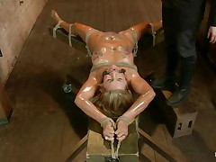 Blonde slut Cameron is all tied up with strings to a wooden table and face hole gagged. With her legs spread, that playgirl gets fingered and has a sex tool on her clitoris. Let`s take a close look at that hot oiled up body and with wax all over her! Will her femdom-goddess make that wench cum if her cunt gets fisted so hard?