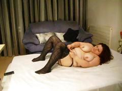 Chubby brunette hair wearing darksome nylons sticks sex toy in her fat cum-hole