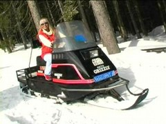 Coldresistant chick undresses on snowmobile