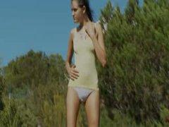 Additional slender girl make striptease outsite