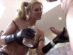 An oiled up Phoenix Marie sucks large penis