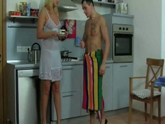 Golden-haired milf receives nailed in the kitchen